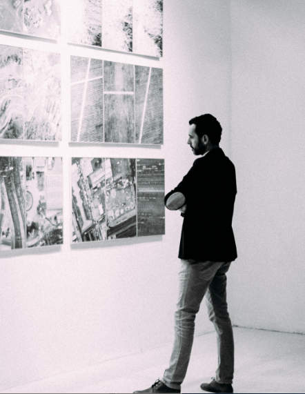 man looking at art gallery